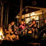 Guests enjoying a cozy outdoor fire at the Tidal Bore Rafting Resort, Nova Scotia