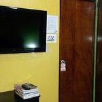 view of tv next to entrance door