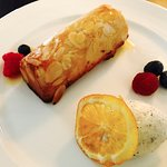 Warm almond cake with praline cream chantilly