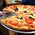 Build your own pizza with tomatoes, feta cheese and spinach