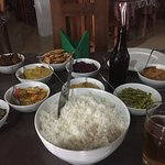 Local food, a great variety of curry dishes, veg dishes, rice and pappadums.