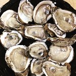 Fresh plump oysters on the half shell are an excellent start to any meal here