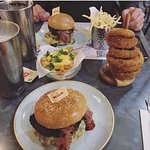 Nice photo of our food before i discovered the burger was full of tomatoes which i'm allergic to