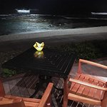 A table at Ulu overlooking the beach at night