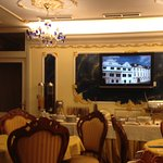Dining area with movie in English on sites to see in Prague and also its history.