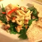 Ceviche - squid and fish cooked with lemon juice rather than heat, served with bread made from y