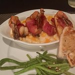 Bacon wrapped prawns over four cheese mac n cheese