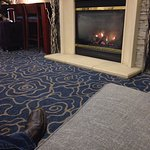 Enjoying coffee and the fire in the lobby.
