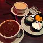 Tasty Chili and New England Clam Chowder with sides of cheese, sour cream and onion