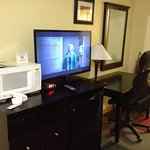 Room with TV Microwave Frige and Desk