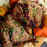 Cider braised pork shoulder with carrots and parsnips.