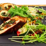 Bacon-wrapped pullet breast stuffed with smoked cheese and rucola