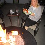 Judy loves the fire-pit and her pizza