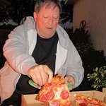 Steve with a slice of pepperoni pizza from Little Joey's