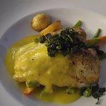 Fish with mango hollandaise sauce