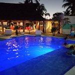 Pool and restaurant / bar at night