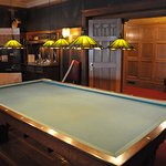 Lower level recreation room with billiards table