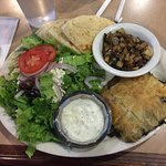 Spanakopita entree with salad and grilled vegetables.