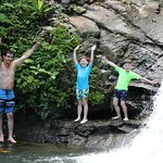 Jimmy (guide) and the kids about to jump in the waterfall pool
