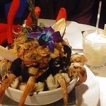 Seafood Paella with nice flower and fried Red Chips