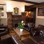 The cosy fireplace area and specials board