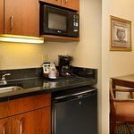 Suites are equipped with microwave, refrigerator and bar sink