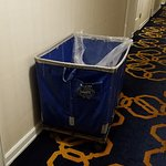 dirty linen hamper outside room at check-in
