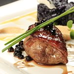 Marinated sirloin steak topped with bluberry sauce