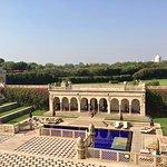 Oberoi pool area facing Taj Mahal in distance