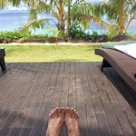 vacation toes on deck of fale