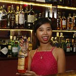 Hoa, our Bar Manager, showcasing our special Middle very rare Irish Whiskey.