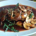 Medallions of Beef on a bed of crushed Potatoes with Mushroom Sauce.