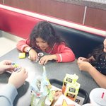 Playing with their toys from the kidsmeal