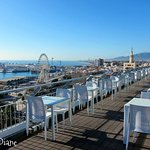 Snacks area on the roof terrace overlooking the port and harbor. A HUGE reason to stay here !