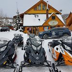 Hotel and snowmobiles are that close to ride.