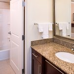 The bathrooms at our suites include wide counters, large mirrors, and fluffy towels.