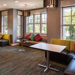 Enjoy some free time in the lobby seating area, offering natural light and cozy furniture.
