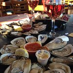 2 dozen raw oysters with wine for appetizer.