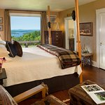 Bear Room with picture view of the lake, king bed, fireplace and private deck.