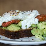 Brioche bread, avocado, oven-dried tomatos, and poached eggs