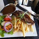 Porterhouse steak with chips, salad & gravy.