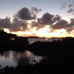 Sunset from the deck, resident iguana in the trees, breakfast on the deck, Dave helping us plan