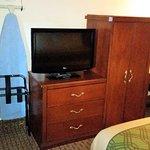 TV, ironing board, desk