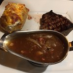 Lady's steak with baked potato, Cesar's salad & onion gravy - fantastic!