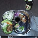 From rice going clockwise: rics, spicy tuna on crispy rice, half salmon fat roll, tuna pok.