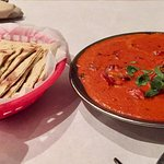 Butter chicken with roti naan.