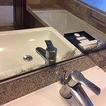 Double Queen Room - pool view. Bathroom - mirror damage