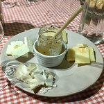 A variety of cheeses with some truffle honey.