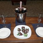 Rose and chocolate covered strawberries as part of the celebration package