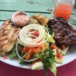 Chicken and ribs (original sauce) combo with home fries and salad